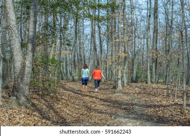 Two Women Walking Down a Trail, Exercising