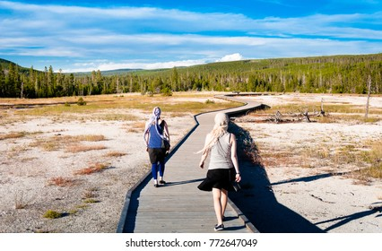Two women walking through the Yellowstone national park