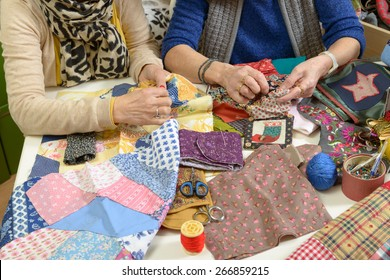 two women working on their patchwork in the workshop