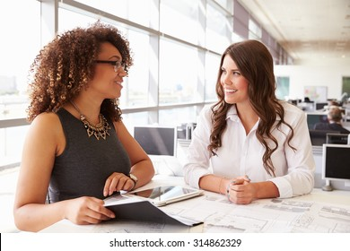 Two women working together at an architect?s office