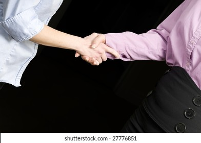 two womens hands shaking or grasping each other
