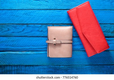 Two women's purse on a blue wooden background. Copy space. Trend accessories. Top view.