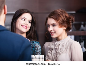 Two wonderful women talk to shop assistant