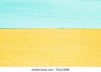 Two wood boards. Blue and yellow wooden boards. Wood texture. The color of sand and wafer like on the beach