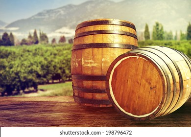 Two wooden barrels on nature background.