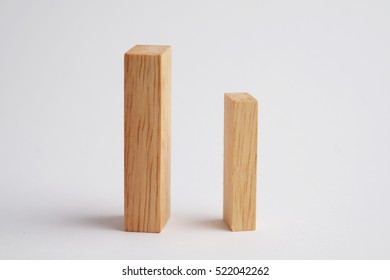 Two wooden block geometric shape on gray background. Business concept of between competition and individuality with big and small.