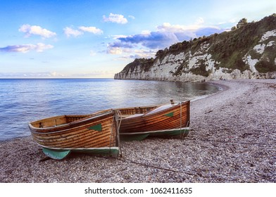 Two wooden boats on a shingle beach