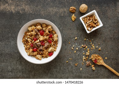 Two wooden bowls of granola on white marble table. Stock image