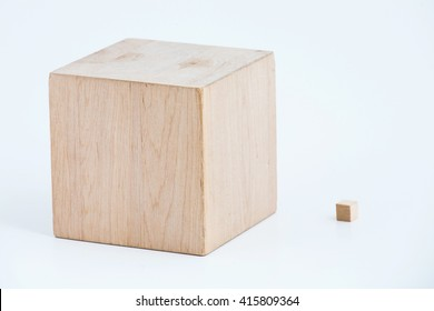 Two wooden cubes of the different size.