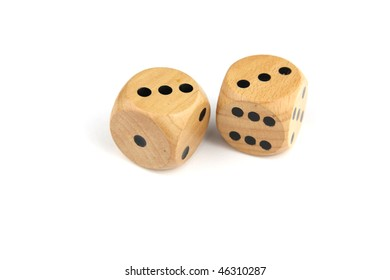 Two wooden dice showing the number six on an isolated white background