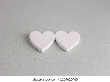 two wooden hearts on craft background