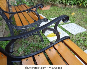 Two Wooden Park Bench at A Park.
