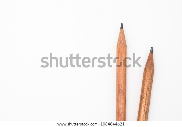 Two wooden pencil isolated on white background