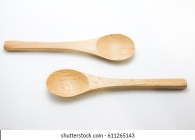 Two wooden spoons on isolated background