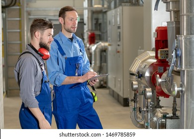 two worker in blue work clothes in industrial plant