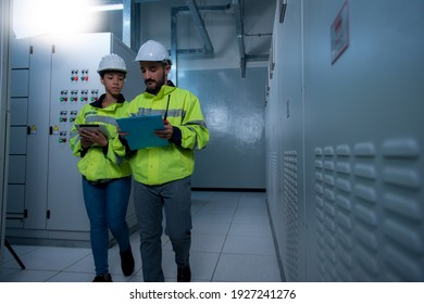 Two worker checking panel in electrical control room on substation. worker in Highvoltage control room