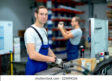 two worker on workbench