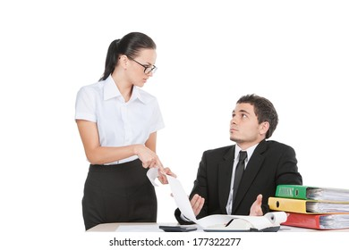 two workers arguing and talking about business. beautiful girl looking at man and pointing at document