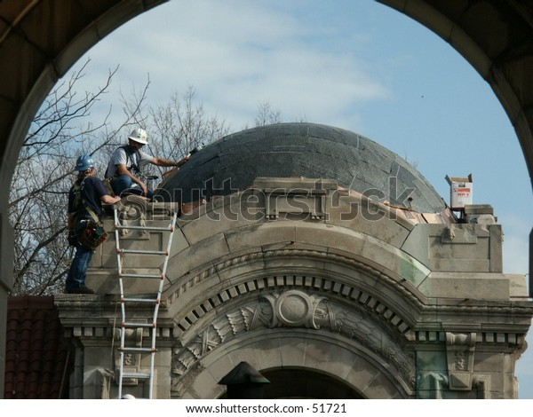 two workers climbing a dome