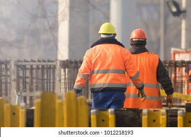 Two workers in orange at the construction site