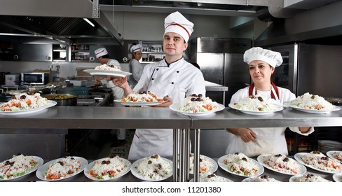 Two workers in a restaurant kitchen