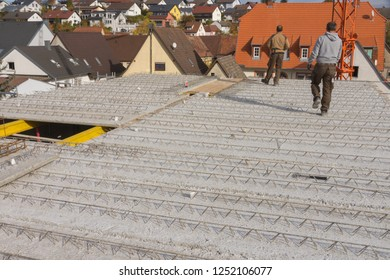 Two workers are walking on concrete precast ceiling