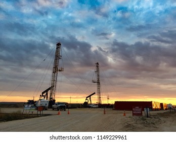 Two Workover Rigs at Sunset Simops
