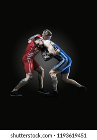 two wrestlers figting isolated on black back