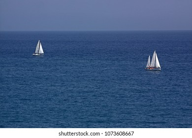 Two yachts floating in the Mediterranean Sea, France. Because of considerable distance to the main object in the atmosphere there is a haze