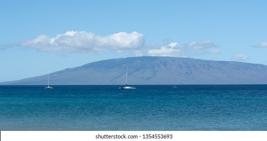 Two yachts on the waters of Maui Kaanapali Hawaii beach, with Lanai Island across.
