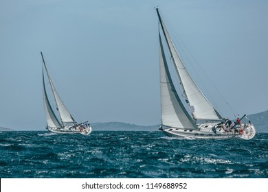 Two yachts racing in a blue sea
