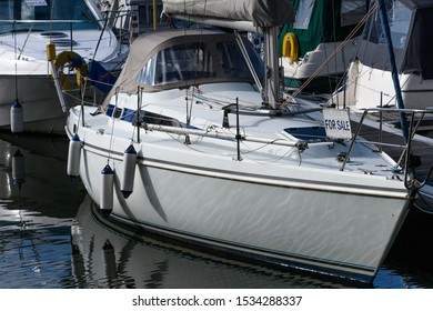 Two yachts for sale in a marina
