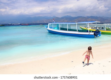 Two years old cute little kid enjoying his time in the sand somewhere between Surf Point beach and  Harbor beach in Gili Trawangan island, one of the most impressive spots in Lombok, Indonesia.