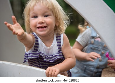 Two years old girl pull hand for her mother invite to play with her.