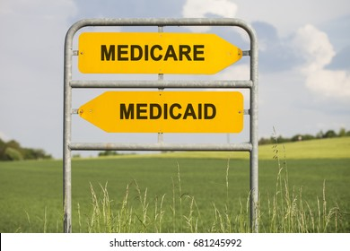 two yellow direction signs with arrows and the words medicare and medicaid, political and social concept for us health care