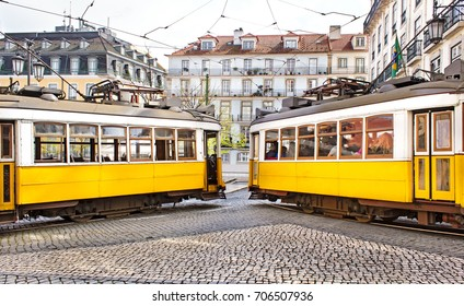 Two yellow vintage trams meeting in Lisbon. These yellow trams are one of the symbols of Lisbon and are great tourist attraction.