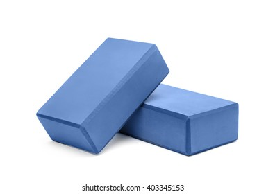 Two yoga blocks isolated on a white background