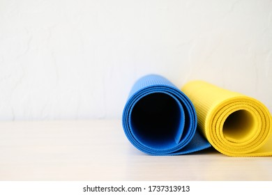 Two yoga mats blue and yellow for background, online training