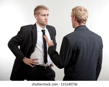 two you businessmen standing, discussing, arguing