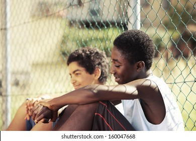 Two young African boy resting outdoors on a sunny day