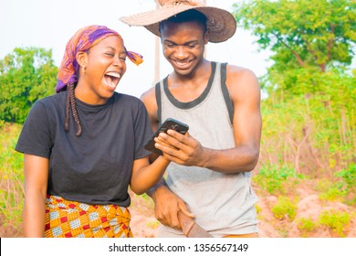 two young African farmers using their smartphone excited