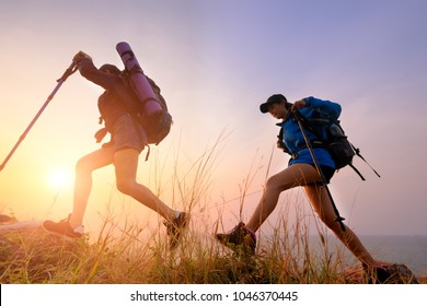 Two young Asian female hipster hiking on mountain holiday, wild adventure. Background for Travel concept