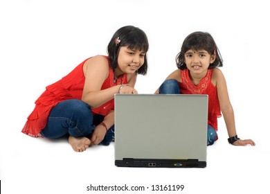 Two young Asian girls using a laptop computer for edutainment
