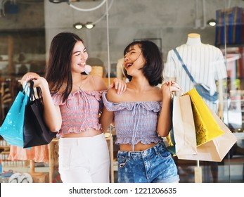 Two young Asian woman Shopping at outlet mall,End of season sale.