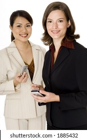 Two young attractive businesswomen using modern communication devices