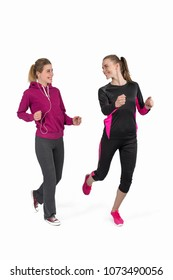 Two young attractive women in sports suitsdo morning jog
