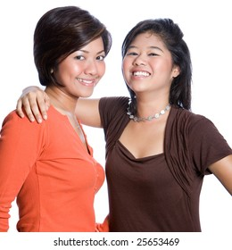 Two young and beautiful Asian sisters