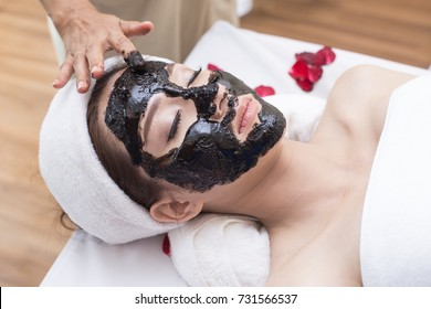 Two Young Beautiful Asian woman with charcoal mask in Spa salon, Spa, health and healing concept.