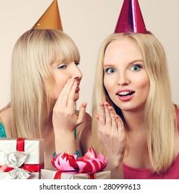 Two young beautiful blonde women celebrating birthday