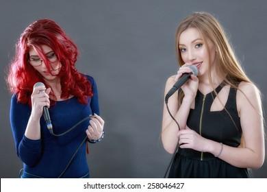 Two young beautiful girls singing